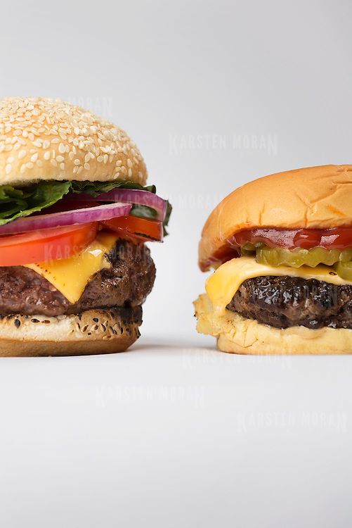 """June 11, 2014 - New York, NY : New York Times writer and editor Sam Sifton describes the difference between """"pub"""" and """"diner""""-style hamburgers. The """"pub"""" burger, which is pictured here at left, is larger, shaped like a fat hockey puck, and takes longer to cook. By contrast the """"diner"""" burger, at right, is smaller, shaped like a frisbee, and cooks substantially quicker. CREDIT: Karsten Moran for The New York Times"""