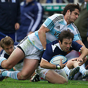 French scrum half Morgan Parr, is tackled by Gonzalo Tiesi, Argentina, during the Argentina V France test match at Estadio Jose Amalfitani, Buenos Aires,  Argentina. 26th June 2010. Photo Tim Clayton...