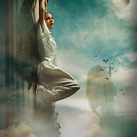 Angel leaning against a column in the sky with a sailing boat in the distance