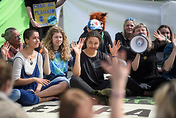 © Licensed to London News Pictures. 18/04/2019. London, UK. Protesters from Extinction Rebellion give hand signals as a form of communication as they occupy Parliament Square for a fourth day. Protesters are demanding urgent government action on climate change. Photo credit: Ben Cawthra/LNP