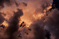 Sunset light creates multiple colors in storm clouds viewed from directly underneath, © 2006 David A. Ponton