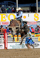 Bull rider GuytinTsosie from Farmington, New Mexico and his mount are fully airborne at the 102nd California Rodeo Salinas, which opened July 19 for a four-day run.