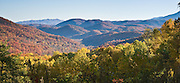 Just west of Sugarlands Visitor Center, Little River Road gives views of mountains and fall leaf colors on the Tennessee side of Great Smoky Mountains National Park. Published 2009 on a dentist office sign in Tennessee. Panorama stitched from 2 overlapping photos.