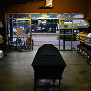 Caskets shops are seen througout San Pedro Sula.  Often casket sellers go to the crime scene and sell the caskets to the family. Gangs, violence and crime are driving Hondurans to immigrant to other countries. February 9, 2017 in San Pedro Sula, Honduras.
