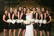 Dec 8, 2012; San Antonio, TX, USA; Bride with bridesmaids pose for formal wedding photos.  Wedding photography taken outside of methodist church in San Antonio.