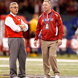 January 4, 2011; New Orleans, LA, USA;  Ohio State Buckeyes head coach Jim Tressel and Arkansas Razorbacks head coach Bobby Petrino talk during warm ups prior to kickoff of the 2011 Sugar Bowl at the Louisiana Superdome.  Mandatory Credit: Derick E. Hingle