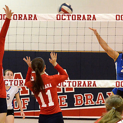 Photos by Tom Kelly IV<br /> East's Caroline Ambrogi (25) spikes the ball over Octorara's Sarah Croft (19) and Maddy Myles (11) during the Downingtown East vs Octorara volleyball game at Octorara on Wednesday October 16, 2013.
