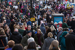 "© Licensed to London News Pictures. 7/12/2013. Lincoln, UK. Lincoln City Centre was packed with Christmas shoppers this weekend. Pictured, The centre of Lincoln main shopping area. Thousands of shoppers filled the City Centre and stewards were called in to direct people up the narrow ""Steep Hill"" towards the upper area of Lincoln near the Cathedral. Photo credit : Dave Warren/LNP"