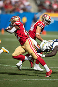 San Francisco 49ers running back Matt Breida (22) runs for a gain of 12 yards and a first down at the Los Angeles Chargers 44 yard line in the first quarter during the NFL week 4 regular season football game against the Los Angeles Chargers on Sunday, Sept. 30, 2018 in Carson, Calif. The Chargers won the game 29-27. (©Paul Anthony Spinelli)