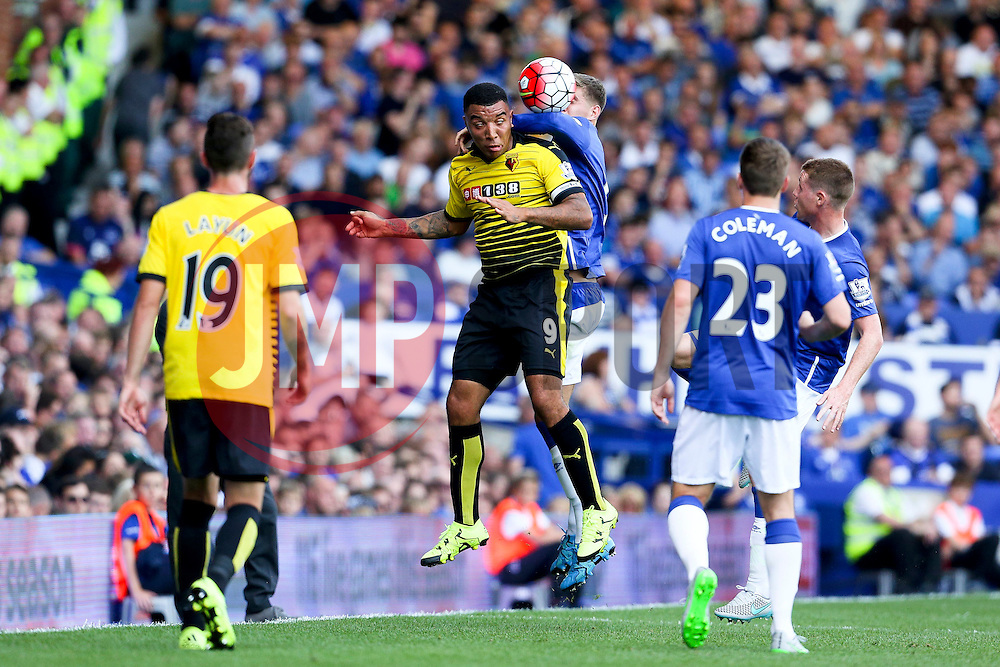 Watford's Troy Deeney challenges for a header with Everton's John Stones - Mandatory byline: Matt McNulty/JMP - 07966386802 - 08/08/2015 - FOOTBALL - Goodison Park -Liverpool,England - Everton v Watford - Barclays Premier League