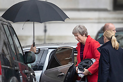 © Licensed to London News Pictures. 03/12/2018. London, UK. London, UK. An umbrella is held aloft as Prime Minister Theresa May arrives at the back entrance to Downing Street. Later The prime minister will brief parliament on the G20 meeting in Argentina. Photo credit: Peter Macdiarmid/LNP