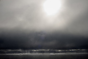 A kayaker moves along the horizon on a foggy morning in Lake Sebago, Maine in 2009.
