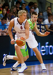 Janis Timma of Latvia vs Matej Rojc of Slovenia during basketball match between National teams of Latvia and Slovenia in Qualifying Round of U20 Men European Championship Slovenia 2012, on July 16, 2012 in Domzale, Slovenia. Slovenia defeated Latvia 69-62. (Photo by Vid Ponikvar / Sportida.com)