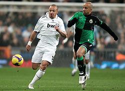 Real Madrid's Julien Faubert against Racing de Santander's Peter Luccin during La Liga match, January 25, 2009.