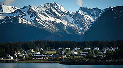 "Early evening sun basks on the town of Haines and the mountains of the Chilkat Range as seen from ""Picture Point"" in southeast Alaska. In the center are the buildings of the former U.S. Army fort, Ft. William H. Seward."
