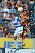 Paul Konchesky  and Ahmed Elmohamady fight for the ball during the Sky Bet Championship match between Hull City and Queens Park Rangers at the KC Stadium, Kingston upon Hull, England on 19 September 2015. Photo by Ian Lyall.
