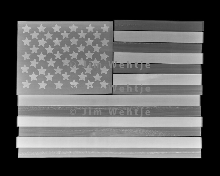 X-ray image of an American flag (white on black) by Jim Wehtje, specialist in x-ray art and design images.