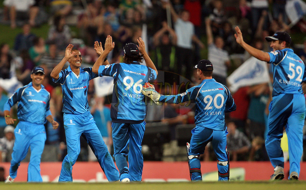 Titans players celebrate a wicket during the 2nd semi-final in the Karbonn Smart CLT20 between the Sydney Sixers and the Titans held at Supersport Park, Centurion, South Africa on the 26th October 2012. Photo by Jacques Rossouw/SPORTZPICS/CLT20
