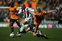 Photo: Rich Eaton.<br /> <br /> Wolverhampton Wanderers v West Bromwich Albion. Coca Cola Championship. 11/03/2007. Diomansy Kamara of West Brom is tackled by Rob Edwards #12 of Wolves