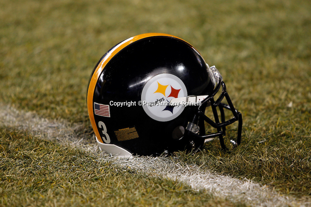 A Pittsburgh Steelers helmet sits on the grass during the NFL 2011 AFC Championship playoff football game against the New York Jets on Sunday, January 23, 2011 in Pittsburgh, Pennsylvania. The Steelers won the game 24-19. (©Paul Anthony Spinelli)