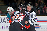 KELOWNA, CANADA - JANUARY 10: Tyrell Goulbourne #12 of Kelowna Rockets drops the gloves with Kyle Burroughs #34 of Medicine Hat Tigers on January 10, 2015 at Prospera Place in Kelowna, British Columbia, Canada.  (Photo by Marissa Baecker/Shoot the Breeze)  *** Local Caption *** Tyrell Goulbourne; Kyle Burroughs;