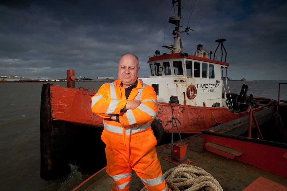 07/01/2012 - Gravesend Skipper Brian Allen with his Dockman Thames tug near Gravesend