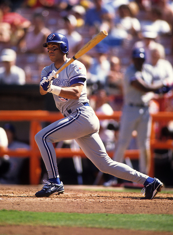 ANAHEIM - 1991:  Roberto Alomar of the Toronto Blue Jays bats against the Anaheim Angels during a 1991 MLB game at the Anaheim Stadium.  Alomar played for the Blue Jays from 1991-1995.  (Photo by Ron Vesely)