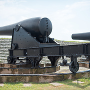 SULLIVAN'S ISLAND, South Carolina - 15-inch Rodman Smoothbore cannons used during the period 1873-1898. Fort Moultrie is part of the Fort Sumter National Monument at the entrance to Charleston Harbor in South Carolina. The fort has played a crucial role in defending the harbor from the time of the Revolutionary War through World War II. During that time it has undergone multiple upgrades, from the original palmetto log walls to the newer heavily fortified earthen bunkers.