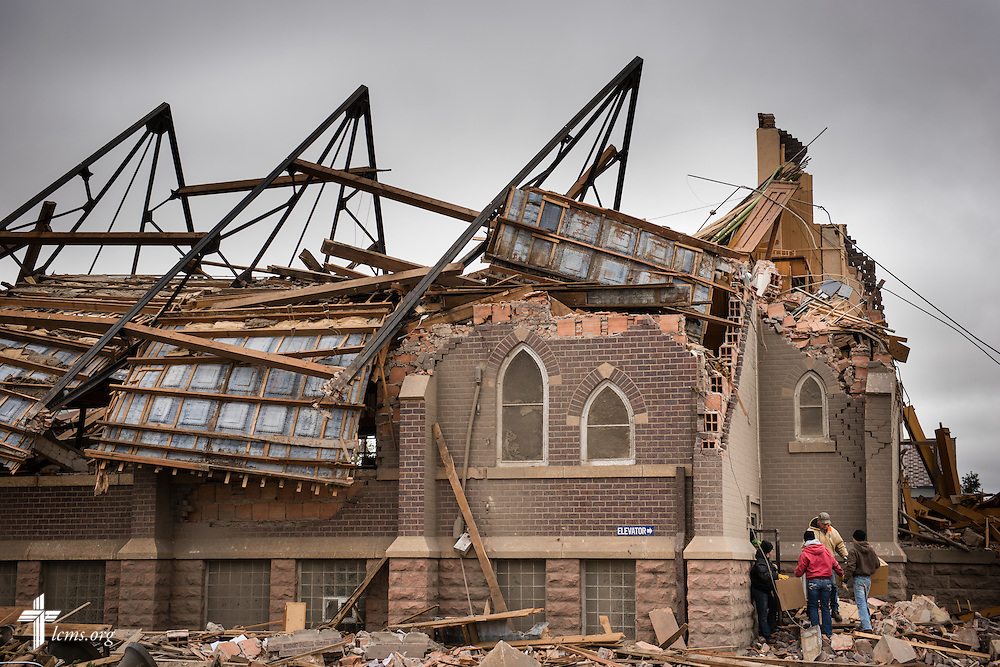 Church workers attempt to salvage cherished items from Zion Lutheran Church on Monday, May 11, 2015, in Delmont, S.D. A tornado swept through the area on Sunday and destroyed the church along with nearby buildings.  LCMS Communications/Erik M. Lunsford