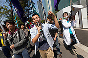 Ikumi Saito (centre) and Makoto Masui (right) lead a protest march at a Zengakuren student union demo at Hosei University Campus. Ichigaya, Tokyo, Japan. Friday April 25th 2014