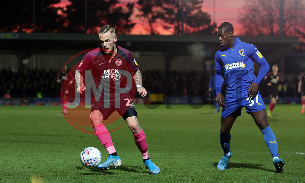 Joe Ward of Peterborough United in action with Paul Osew of AFC Wimbledon - Mandatory by-line: Joe Dent/JMP - 18/01/2020 - FOOTBALL - Cherry Red Records Stadium - Kingston upon Thames, England - AFC Wimbledon v Peterborough United - Sky Bet League One