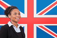 Young African American businesswoman smiling over British flag