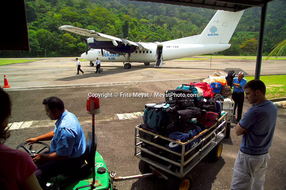 Air Batang, ABC, Pulau Tioman, Malaysia, March 2006. Tioman airport has the shortest runway situated in between 2 mountains, the baggage handling is also primitive. Tioman island is surrounded by beautiful coral reefs and offers spectacular diving and snorkling. Photo by Frits Meyst/Adventure4ever.com