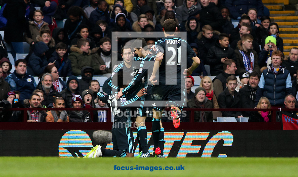 Eden Hazard (2nd left) of Chelsea celebrates scoring his sides first goal with his team mates Willian (left) Oscar (2nd right) and Nemanja Matić (right)  during the Barclays Premier League match at Villa Park, Birmingham<br /> Picture by Tom Smith/Focus Images Ltd 07545141164<br /> 07/02/2015