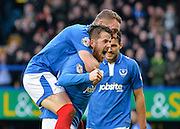 Portsmouth players celebrate Portsmouth striker Marc McNulty goal during the Sky Bet League 2 match between Portsmouth and Crawley Town at Fratton Park, Portsmouth, England on 2 January 2016. Photo by Adam Rivers.