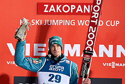 Poland, Zakopane - 2018 January 28: Anze Semenic from Slovenia celebrates during awarding ceremony his victory in 18th World Cup Competition Men's HS140 Large Hill Individual during FIS Ski Jumping World Cup Zakopane 2017/2018 - Day 3 at Wielka Krokiew jumping hill on January 28, 2018 in Zakopane, Poland.<br /> <br /> Mandatory credit:<br /> Photo by &copy; Adam Nurkiewicz<br /> <br /> Adam Nurkiewicz declares that he has no rights to the image of people at the photographs of his authorship.<br /> <br /> Picture also available in RAW (NEF) or TIFF format on special request.<br /> <br /> Any editorial, commercial or promotional use requires written permission from the author of image.