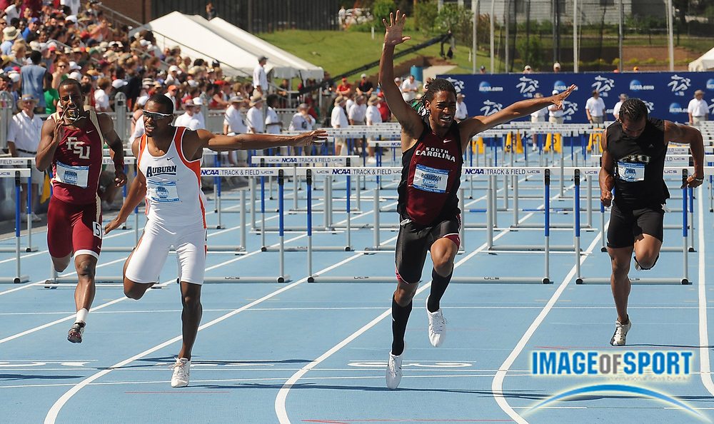 Jun 14, 2008; Des Moines, IA; Jason Richardson of South Carolina, second from right, celebrates after winning the 110m hurdles in 13.40 in the NCAA Track & Field Championships at Drake Stadium. Ty Akins of Auburn, second from left, was second in 13.46. Drew Brunson of Florida State, left, was fifth in 13.80. Ronald Forbes of Florida International was eighth in 14.05.