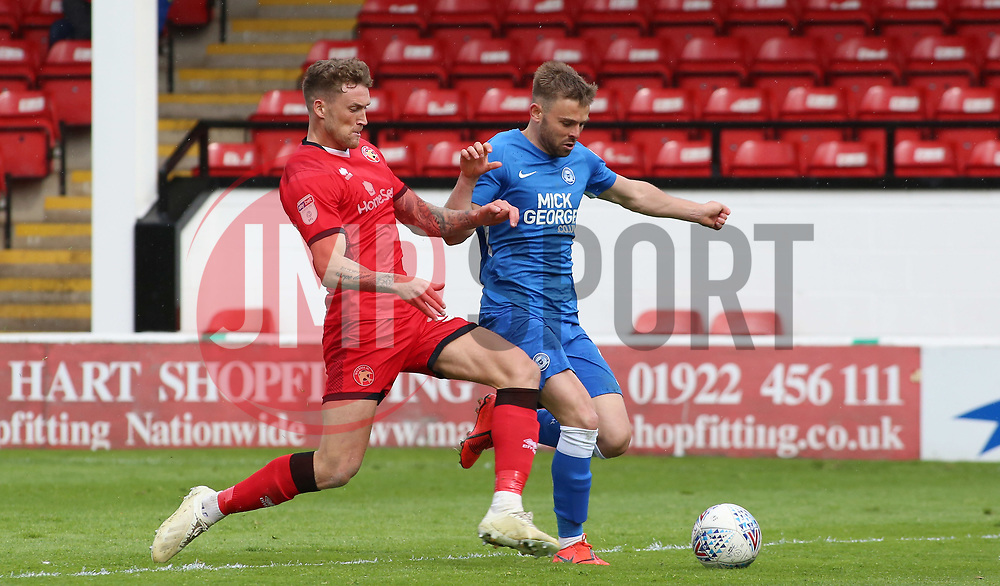 Matt Godden of Peterborough United is tackled by Dan Scarr of Walsall - Mandatory by-line: Joe Dent/JMP - 27/04/2019 - FOOTBALL - Banks's Stadium - Walsall, England - Walsall v Peterborough United - Sky Bet League One