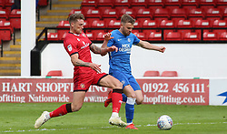 Matt Godden of Peterborough United is tackled by Dan Scarr of Walsall - Mandatory by-line: Joe Dent/JMP - 27/04/2019 - FOOTBALL - Banks's Stadium - Walsall, England - Walsall v Peterborough United - Sky Bet League One
