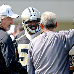 Jul 26, 2013; Metairie, LA, USA; New Orleans Saints defensive coordinator Rob Ryan talks with linebacker coach Joe Vitt and linebacker Curtis Lofton (50) during the first day of training camp at the team facility. Mandatory Credit: Derick E. Hingle-USA TODAY Sports
