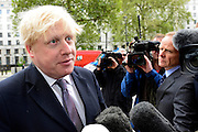 © Licensed to London News Pictures. 23/05/2013. London, UK London Mayor Boris Johnson talks to media ahead of a meeting of COBRA (Cabinet Office Briefing Room A) to discuss yesterday's alleged terrorist attack in Woolwich. Photo credit : Stephen Simpson/LNP