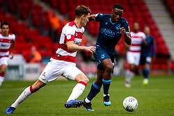 Victor Adeboyejo of Bristol Rovers takes on Joe Wright of Doncaster Rovers - Mandatory by-line: Robbie Stephenson/JMP - 19/10/2019 - FOOTBALL - The Keepmoat Stadium - Doncaster, England - Doncaster Rovers v Bristol Rovers - Sky Bet League One