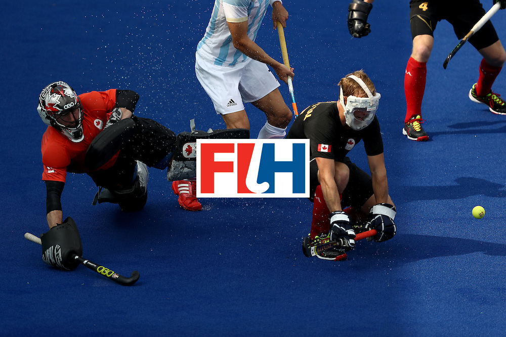 RIO DE JANEIRO, BRAZIL - AUGUST 08:  David Carter #30 and Gordon Johnston #16 of Canada block a shot against Argentina during a Pool B match on Day 3 of the Rio 2016 Olympic Games at the Olympic Hockey Centre on August 8, 2016 in Rio de Janeiro, Brazil.  (Photo by Sean M. Haffey/Getty Images)