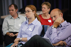 Employees listening during a session at an NHS Training event on staff development,
