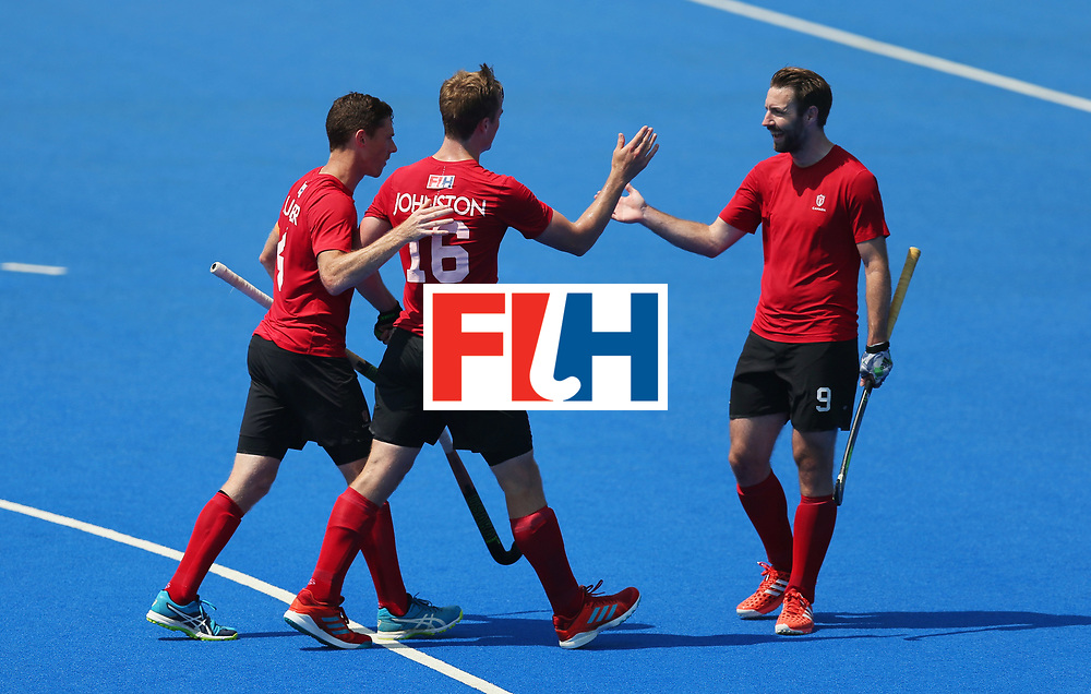 LONDON, ENGLAND - JUNE 20:  Gordan Johnston of Canada (16) celebrates as he scores their first goal with team mates during the Pool B match between Scotland and Canada on day six of the Hero Hockey World League Semi-Final at Lee Valley Hockey and Tennis Centre on June 20, 2017 in London, England.  (Photo by Alex Morton/Getty Images)