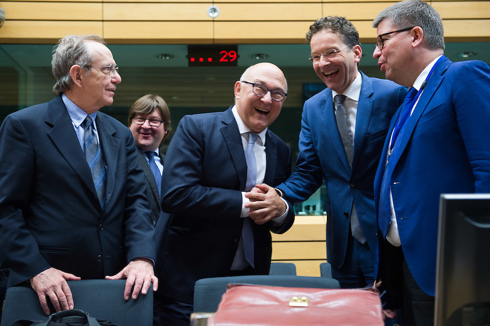 Brussels 11 July 2015<br /> <br /> Eurogroup - Meeting of the eurozone finance ministers to discuss the recent request by the Greek authorities for financial assistance from the European Stability Mechanism (ESM) and their new proposals for a reform agenda.<br /> <br /> Pix Pier Carlo Padoan Michel Sapin Jeroen Dijsselbloem<br /> <br /> Credit Melanie Wenger / Isopix