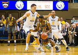 Nov 23, 2015; Morgantown, WV, USA; Bethune-Cookman Wildcats guard Ricky Johnson is trapped by West Virginia Mountaineers forward Nathan Adrian during the first half  at WVU Coliseum. Mandatory Credit: Ben Queen-USA TODAY Sports
