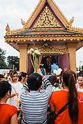 Making offerings at the Dorngkeur Shrine on Preah Sisowath Quay, Phnom Penh