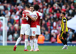 Arsenal's Mesut Ozil embraces Granit Xhaka at full time