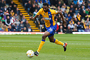 Mansfield defender Hayden White runs with the ball during the EFL Sky Bet League 2 match between Mansfield Town and Portsmouth at the One Call Stadium, Mansfield, England on 29 April 2017. Photo by Aaron  Lupton.